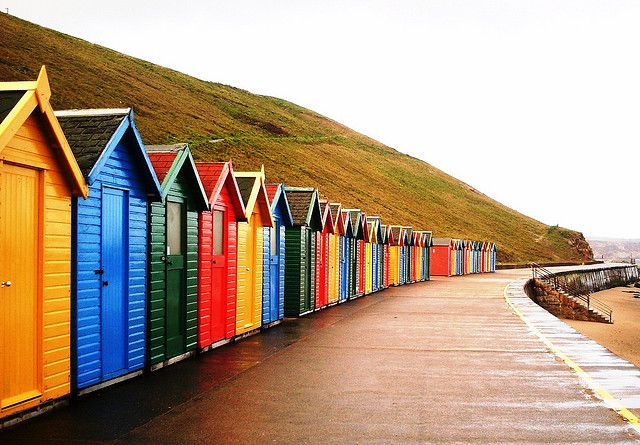 Beach huts in Whitby, England Got my pic taken in front of these in 2010. Loved Whitby...