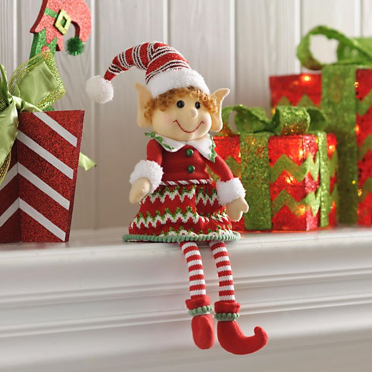 Our Jolly Elf Girl Shelf Sitter will make your mantel or book shelf display pop with color and holiday cheer. Her adorably warm smile will melt your guests' hearts.