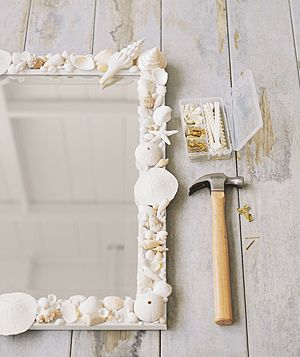 Seashell mirror - you will need a framed mirror, craft glue, a paintbrush (to apply glue), and seashells of various kinds and sizes. Repeating similarly shaped elements, such as sand dollars or sea urchins, and using a limited palette will make the piece look harmonious.