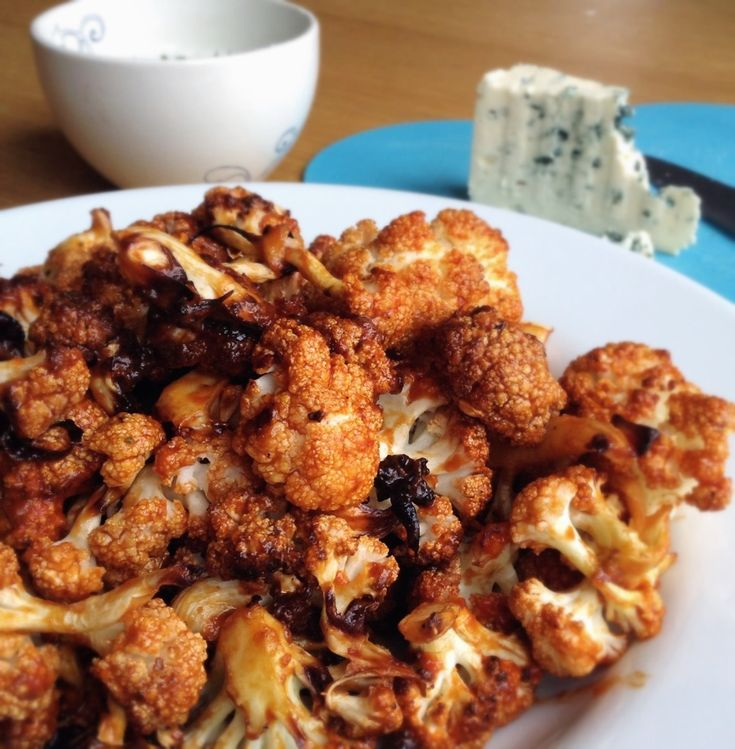 Spicy cauliflower wings with honey garlic sauce. Perfect for the big game!