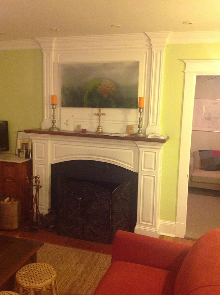 English Paneled Room: Raised Panel Mantel With Pilasters Above And Arch Over