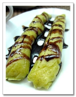 Suman Or Budbud Kabog Sticky Glutinous Rice Cake Served Wrapped In Banana Leaves