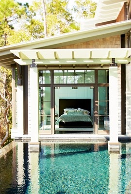 Bedroom overlooking a pool