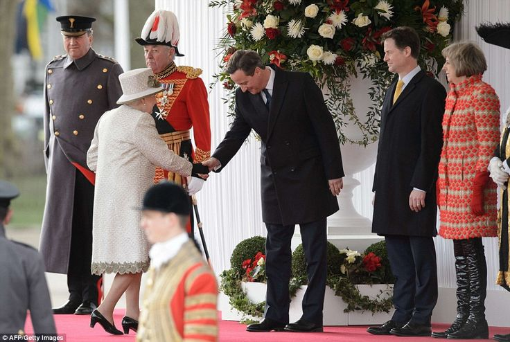 Taking part: David Cameron bows to the Queen as he waits for the Mexican couple to arrive alongside Theresa May and Nick Clegg