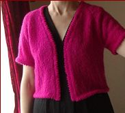 Knitting pattern for a ladies short sleeve jacket, in plus sizes.