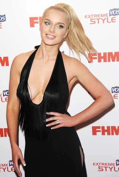 Helen Flanagan Lookbook: Helen Flanagan wearing Halter Dress (2 of 7). Helen Flanagan chose a super sexy red carpet look when she chose this V-neck gown with a fringe detailed neckline and a side slit.