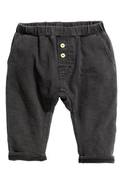Slub jersey trousers: BABY EXCLUSIVE. Trousers in slub cotton jersey with an elasticated waist, fake fly with buttons, side pockets and one back pocket.
