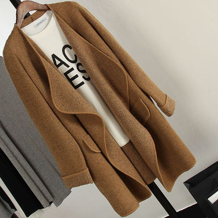 This loose knitted cardigan coat is with street style will make you fashion and charming. Features with pockets and lapel collar make it more unique and eye-catching. Size: Length 73cm, Shoulder 40cm,