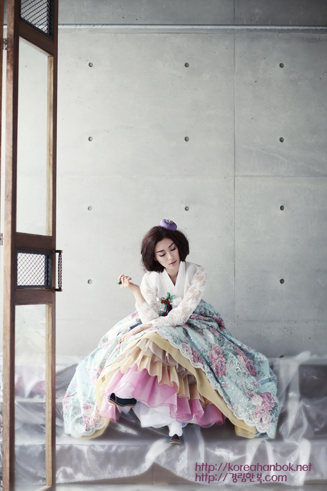 I love the contrast of her soft layered dress against the modern and sparse backdrop. (Korean traditional dress by Kyung Lim Hanbok)