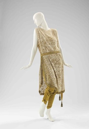 A circa-1910 yellow and beige silk evening jumpsuit that is attributed to Callot Soeurs.    http://elogedelart.canalblog.com/tag/Jean-Philippe%20Worth