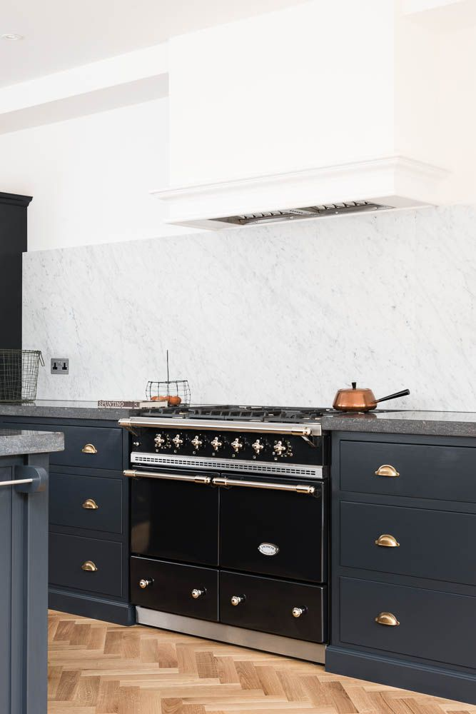 Lacanche cooker and Carrara marble splashback in the Victoria Road NW6 Kitchen by deVOL