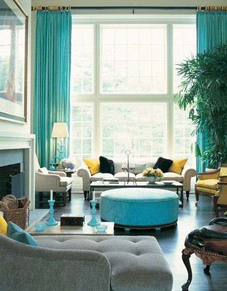 Draw attention to extra-tall windows with bright drapery.      Master colourist…