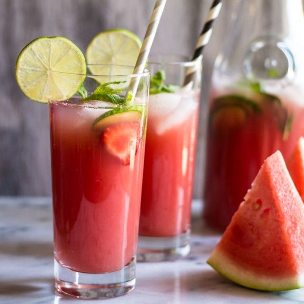 Sugar-Free Watermelon Strawberry Agua Fresca Recipe Beverages with watermelon, strawberries, lime juice, apple cider, water, ice cubes, lime slices, cucumber, mint leaves