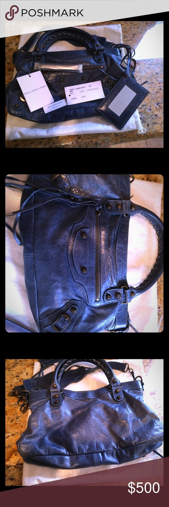 Balenciaga First City Classic Near perfect condition beautiful blue leather 100% authentic Balenciaga Classic City bag. Comes with dust bag and original tags, mirror, extra tassels. Slight fading of leather in bottom corners Balenciaga Bags Satchels