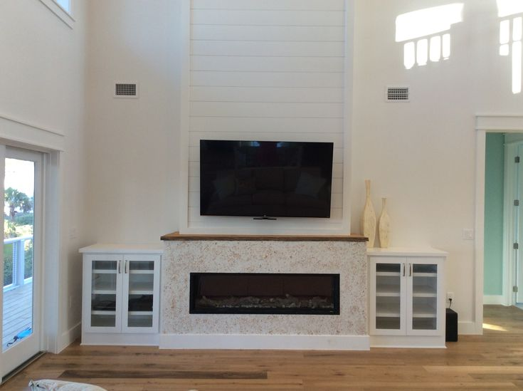 mantlemount  tv over linear fireplace  tabby stucco fireplace remodel ideas with shiplap brick fireplace remodel ideas