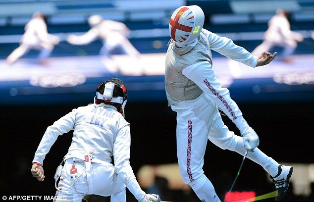Britain's James Davis (right) faces off against Egypt's Tarek Ayad in the fencing team foil