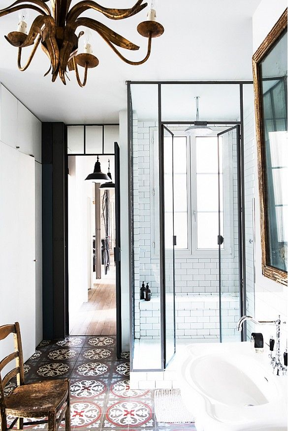 Pattered Tile Floor and Iron Shower Doors