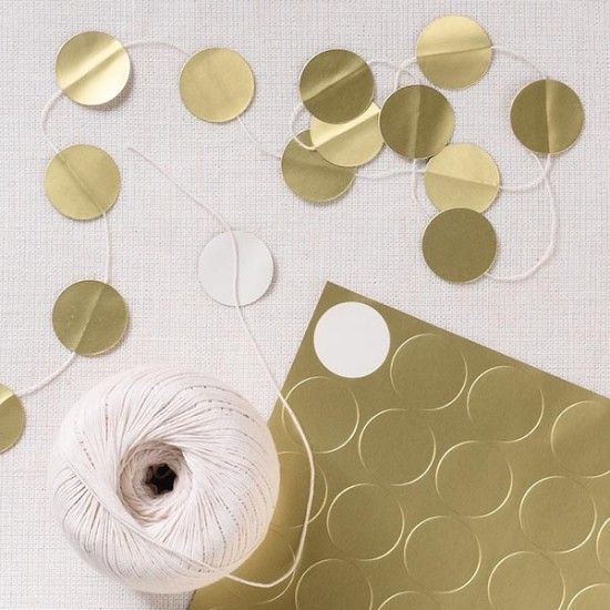 A simple garland of string & metallic stickers. -Could also be sending craft paper +?punch and secure with glue dot or double sided tape..