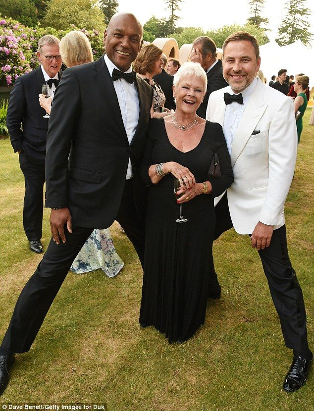 Goofing around: Dame Judi shared a laugh with former Bond co-star Colin Salmon (left) and ...