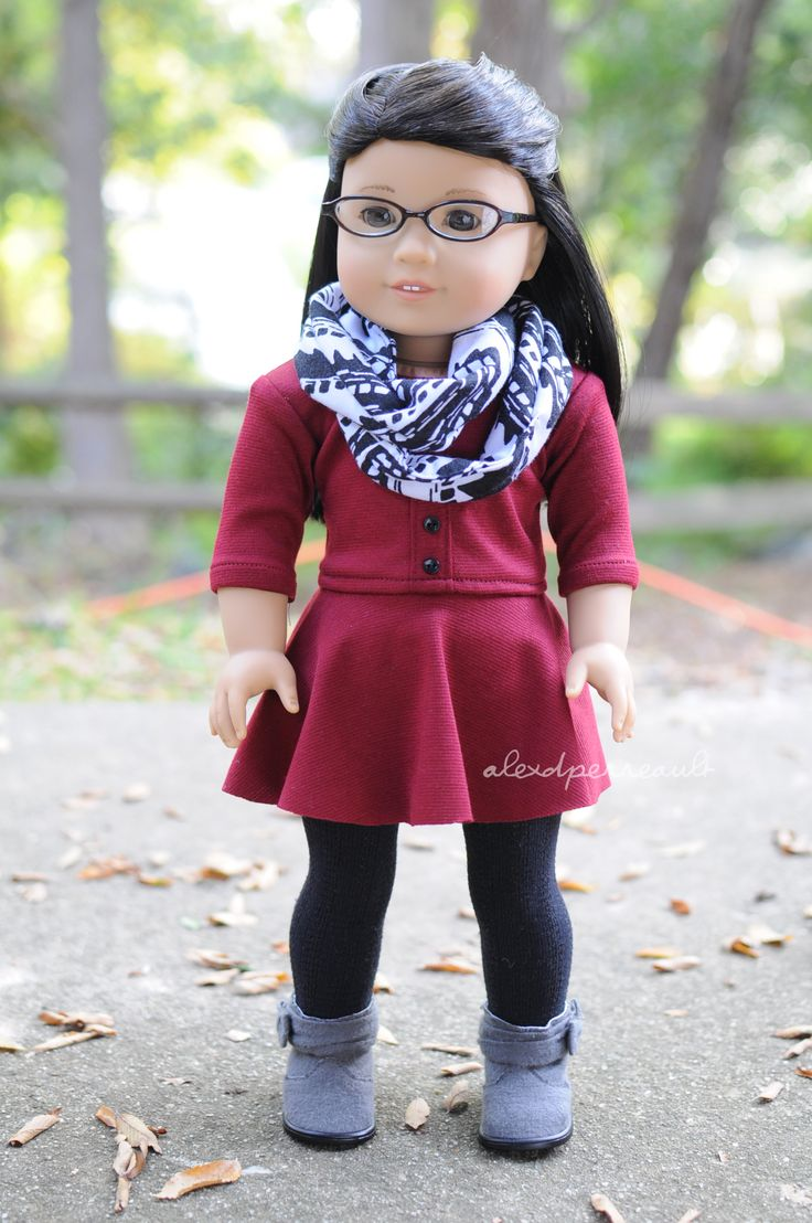 Dress by Anick's Boutique, scarf by Dollicious Doll Clothes, and tights and boots are AG brand. American Girl