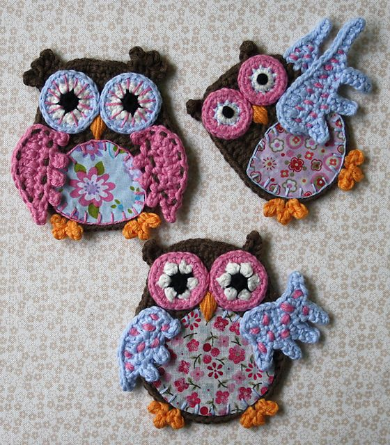 How cute is this!?  Crocheted owls with little appliqued fabric pieces!  Would be so cute appliqued to some overalls:)