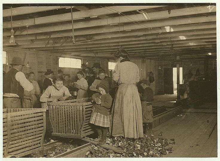 Four-year-old Mary, who shucks two pots of oysters a day at Dunbar. Tends the baby when not working. (See photo 2062). The boss said that next year Mary will work steady as the rest of them. The mother is the fastest shucker in the place. Earns $1.50 a day. Works part of the time with her sick baby in her arms. Father works on the dock. Location: Dunbar, Louisiana.