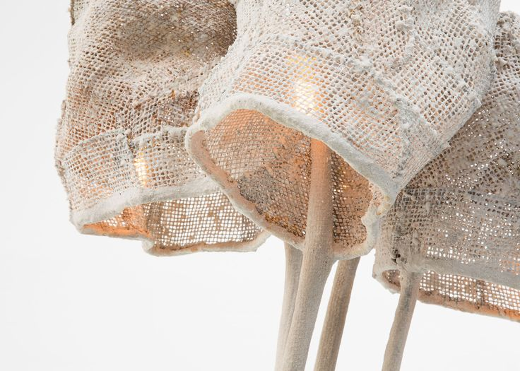 Spanish designer Nacho Carbonell has encased lights in loose cocoons of coloured mesh for his Light Mesh solo exhibition.