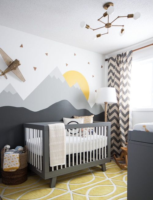 The charcoal furniture in this modern nursery is the perfect gender-neutral canvas, but we're loving the mural. A simple mountain design anyone can do makes a big statement in this flying-above-the-clouds nursery.