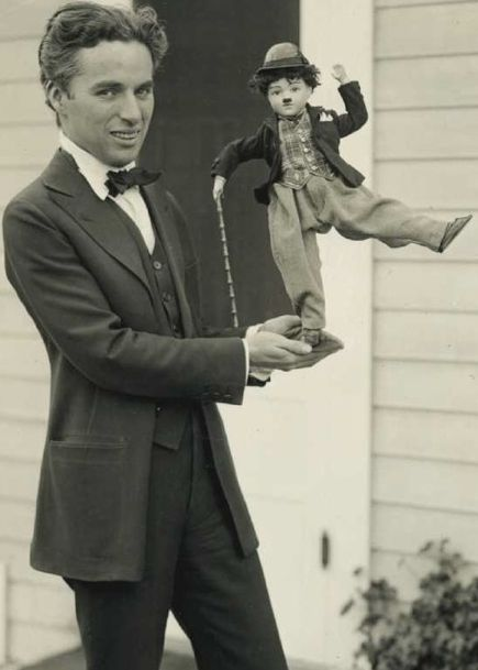 """Charlie Chaplin with """"Little Tramp doll"""" (1929)"""