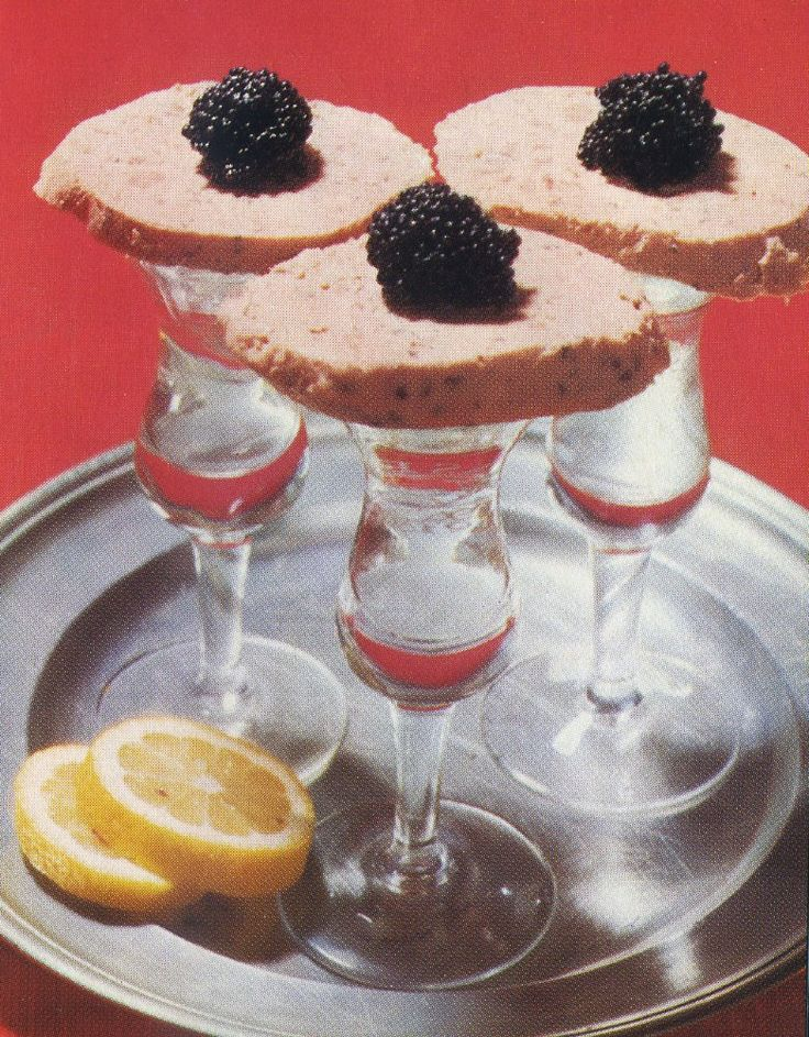 'Hamburg Welcome' – Slices of liverwurst topped with caviar and served on Korn (grain spirit) shot glasses.