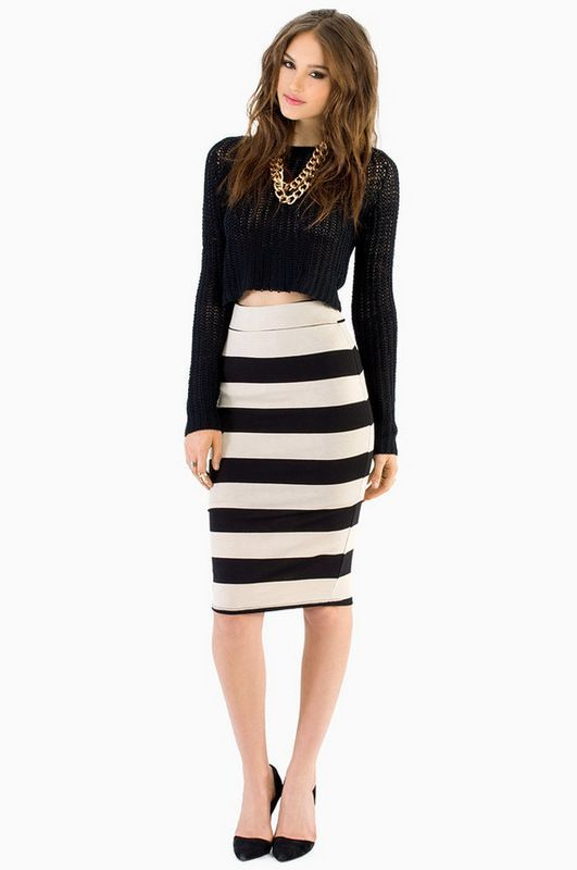 Rock a black cropped sweater with a white and black horizontal striped pencil skirt to effortlessly deal with whatever this day throws at you. Take a classic approach with the footwear and throw in a pair of black suede pumps.   Shop this look on Lookastic: https://lookastic.com/women/looks/black-cropped-sweater-white-and-black-pencil-skirt-black-pumps-gold-necklace/7665   — Gold Necklace  — Black Cropped Sweater  — White and Black Horizontal Striped Pencil Skirt  — Black Suede Pumps