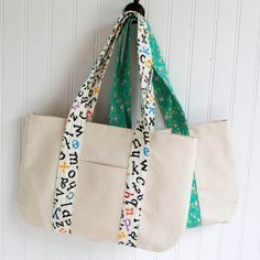 Someone's going to win a tote bag full of delightful children's books from Brightly. Click here to enter and you might soon be reading the books to your own kids or grandkids. In the meantime, I thought I might share a book bag sewing tutorial of my own...