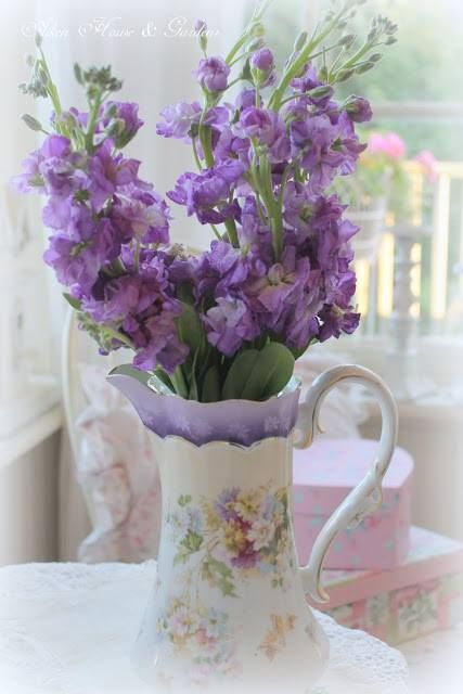 antique pitcher with purple flowers
