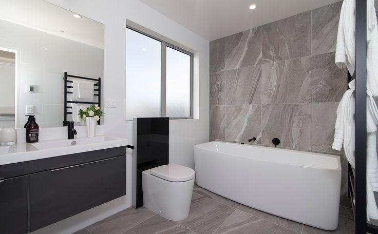 Beautiful tiles and bath!  | Hobsonville Point | GJ Gardner Homes