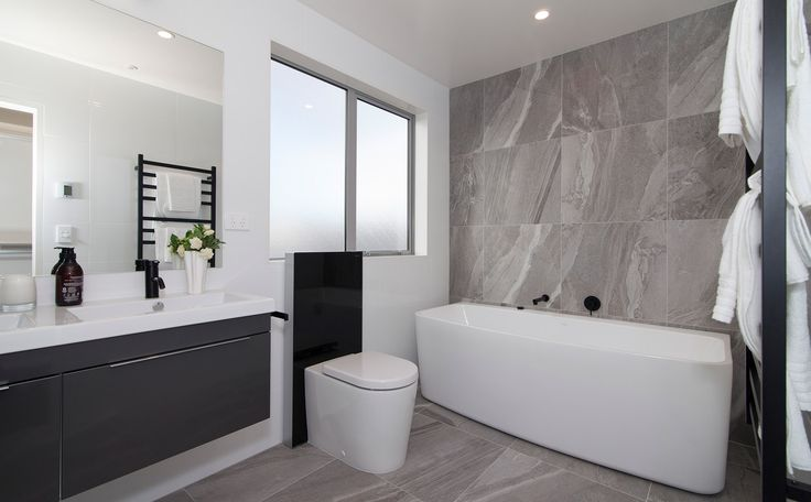 Beautiful tiles and bath!  | Hobsonville Point | GJ Gardner Homes
