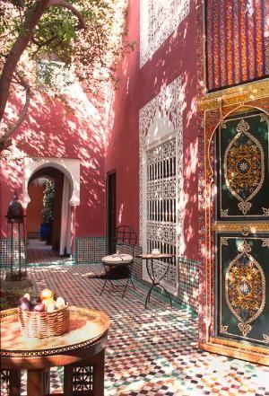 Sun-dappled courtyard at Riad Kaiss in Marrakech, Morocco by Eva0707