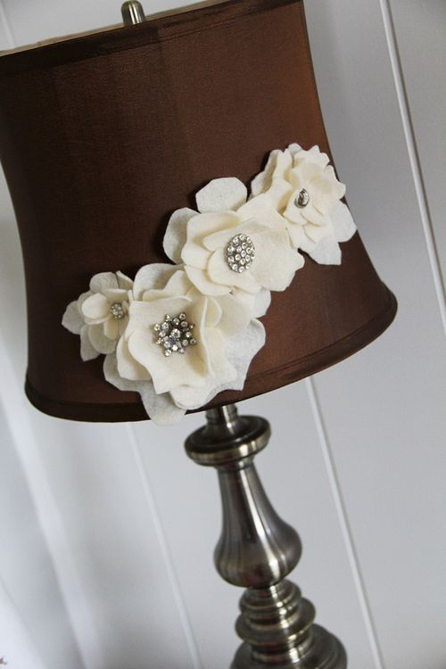 Hot glue felt flowers onto a lamp shade to dress it up.- like the brown and white/ cream color combo