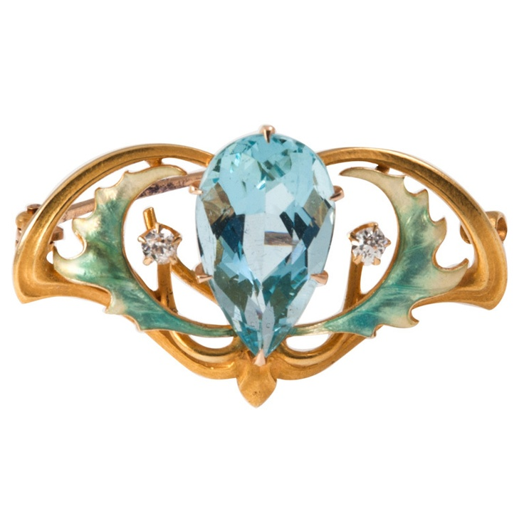 Art Nouveau enamelled pin set with drop shaped faceted Aquamarine and two small Diamonds. On reverse curved hook for addition if required. Circa 1900: