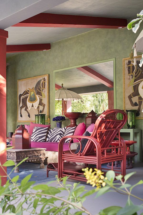 Kathy and Billy Rayner's house represents a magical metamorphosis of non-descript ranch into outpost of chic wanderlust. Peter Marino performed the transformation, including exotic wall treatments in the library below~~Palm Beach Chic Bolander terrace