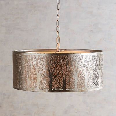 Nothing suggests winter serenity like the stark silhouette of bare birch trees. Our pendant light is no exception, with its birch shade casting a peaceful glow over any space. Laser-cut iron creates a landscape of tree trunks, with a painted silver finish and inner fabric liner to spread the light. Forecast: Serene.