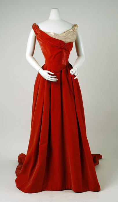 A red velvet Worth ball gown dating between 1898 and 1900