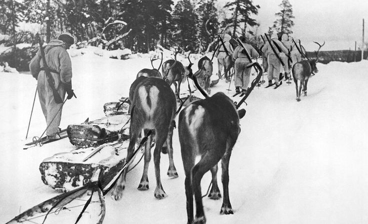 Finnish soldiers, members of one of the ski battalions that fought against invading Russian troops, march with their reindeer on March 28, 1940.