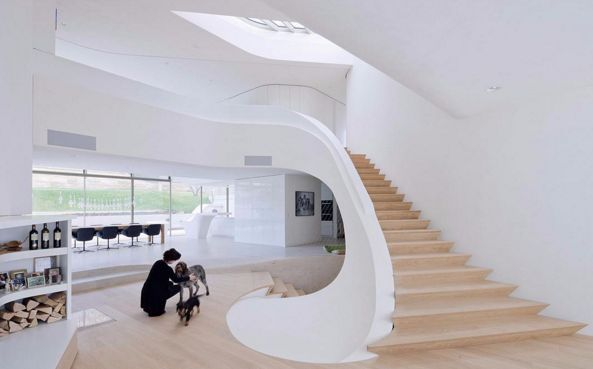 Haud Am Weinberg by UNStudio. The staircase seems to 'spill' onto the floor in an organic way.