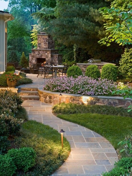 Nice walkway, flowers and sitting area with fireplace
