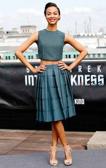 A skirt like Zoe Saldana's Calvin Klein Collection version is perfect for the office, stylist George Kotsiopoulos tells Us. Best paired with a sweater and a chunky heel to moderninze the look, the skirt can also be worn with a crop top for evening.
