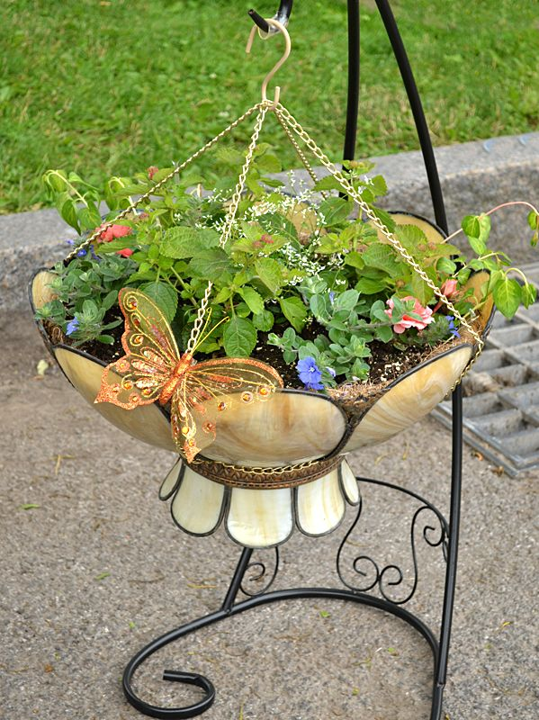 Looking at objects in a different way– in this case upside down– can help you create unusual container gardens.