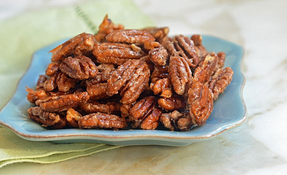"""My husband calls these candied pecans """"crack nuts"""" because they're madly addictive. They're perfect to serve with cocktails, toss over salads or just keep around the house over the holidays. They also make a delicious homemade gift.  The best part? You only need four simple ingredients to make them — and if you start right now, you'll be …"""