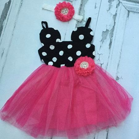 This Minnie Mouse Birthday Dress in Bright Pink is perfect for your little ones special day! This item comes complete with adorned matching flower and matching flower headband. Perfect for those special photos and birthday themes. For your Disney lover and vacation!