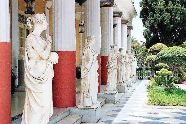 This photo was taken in the Imperial Gardens at the Achilleion Palace in Corfu, Greece. The Palace was named after the Greek hero Achilles. This photo shows some of the statues of the Greek Muses that line the courtyard garden which leads to a beautiful view overlooking the Ionian Sea.