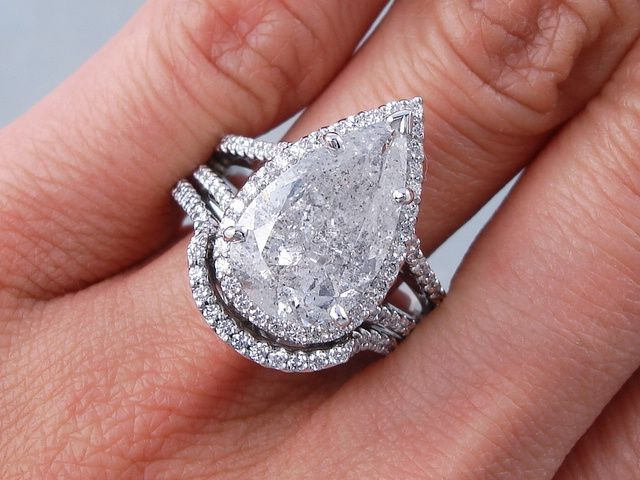 5.14 ctw Pear Shape Diamond Engagement Ring and Matching Wedding Band Set. It has an engaging 4.16 ct F color/I1 clarity, Clarity Enhanced (Fracture Filled and Laser Drilled) Pear Shape Center Diamond. Set in a gorgeous 14K white gold setting, this set is listed for $14,190! Follow this link to view this listing on our website:  http://www.bigdiamondsusa.com/5ctwpeshdiwe1.html  Email: diamonds@bigdiamondsusa.com Website: www.BigDiamondsUSA.com